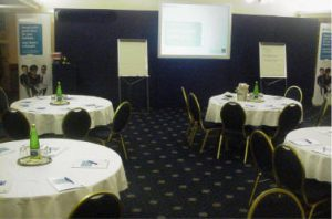 Conference room set up in round table layout