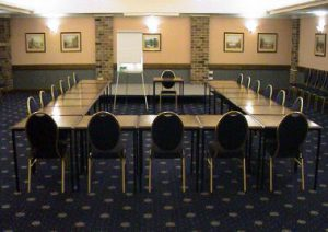 Conference room set up in a U shape layout