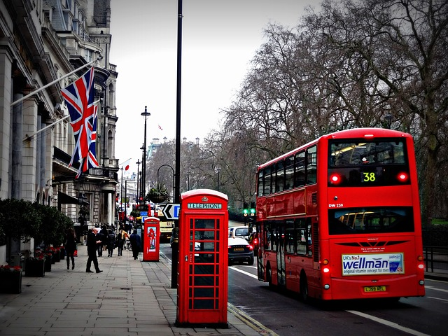 London street with bus, telephone boxes and flags